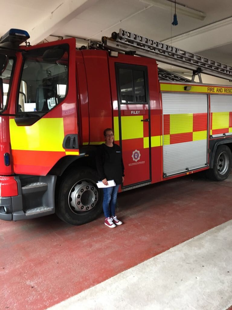 Intrinsic employee next to fire engine